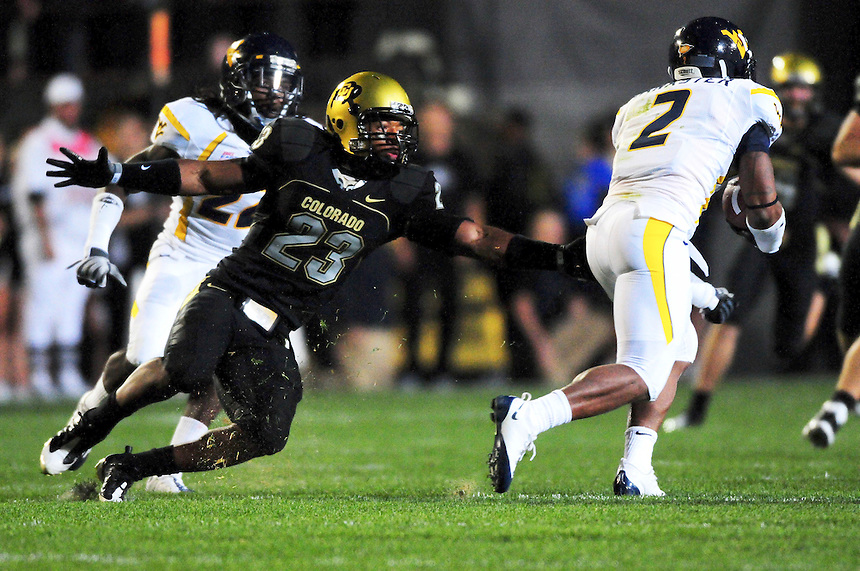 18 September 08: Colorado cornerback Jalil Brown (23) can't come up with a tackle on West Virginia back Ellis Lankster (2). The Colorado Buffaloes defeated the West Virginia Mountaineers 17-14 in overtime at Folsom Field in Boulder, Colorado. For Editorial Use Only.