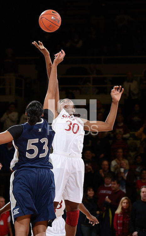 STANFORD, CA - DECEMBER 28: Nnemkadi Ogwumike of Stanford women's basketball goes up at the tip-off at the start of a  game against Xavier on December 28, 2010 at Maples Pavilion in Stanford, California.  Stanford topped Xavier, 89-52.