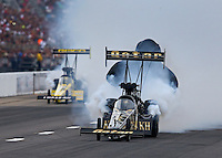 Sep 28, 2013; Madison, IL, USA; NHRA top fuel dragster driver Khalid Albalooshi (right) alongside Morgan Lucas during qualifying for the Midwest Nationals at Gateway Motorsports Park. Mandatory Credit: Mark J. Rebilas-
