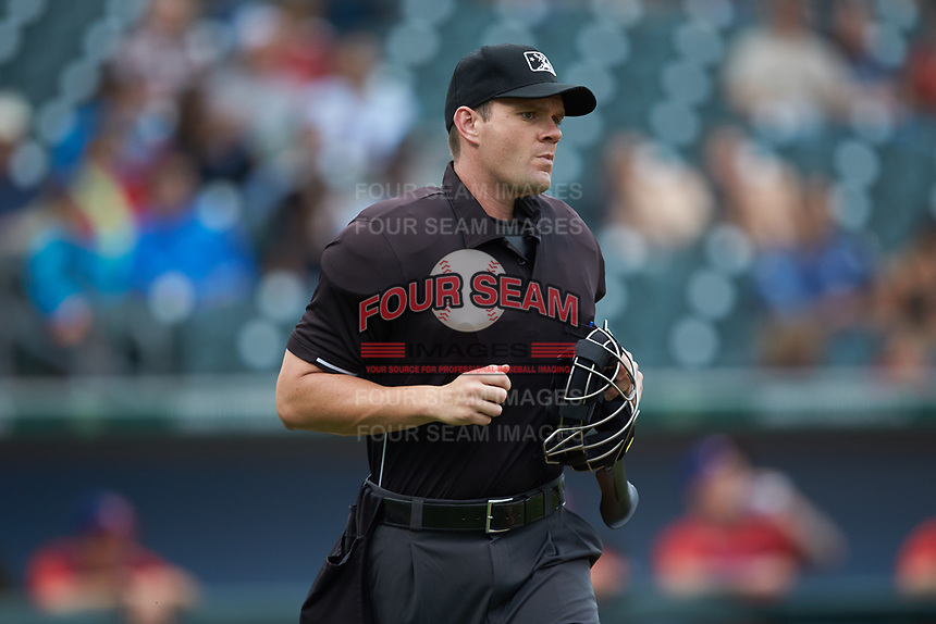 Home plate umpire Adam Beck hustles to get in position to make a call during the International League game between the Buffalo Bisons and the Caballeros de Charlotte at BB&T BallPark on July 23, 2019 in Charlotte, North Carolina. The Bisons defeated the Caballeros 8-1. (Brian Westerholt/Four Seam Images)