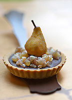 A pear and chocolate tartlet decorated with glace chestnuts