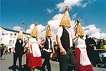Strawboys take to the streets for some traditional Irish dancing during the Fleadh Nua parade in Ennis - date unknown (1998-2000). Photograph by John Kelly