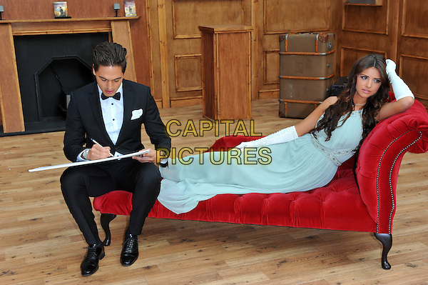Mario Falcone and Lucy Mecklenburgh open a replica of Rose's cabin at Westfield London to launch the release of Titanic on Blu-ray and Blue-ray 3D London, England..September 11th, 2012.TOWIE full length tuxedo drawing sketch sketching white black bow tie sitting green dress long gloves couple .CAP/CJ.©Chris Joseph/Capital Pictures.