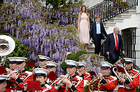 United States President Donald Trump, First Lady Melania Trump and son Barron Trump attend the annual Easter Egg Roll on the South Lawn of the White House  in Washington, DC, on April 17, 2017. <br /> CAP/MPI/CNP/RS<br /> &copy;RS/CNP/MPI/Capital Pictures