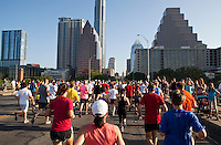 Nearly 23,000 runners and joggers run past the Congress Ave. Bridge in an annual 10K race in downtown Austin, Texas