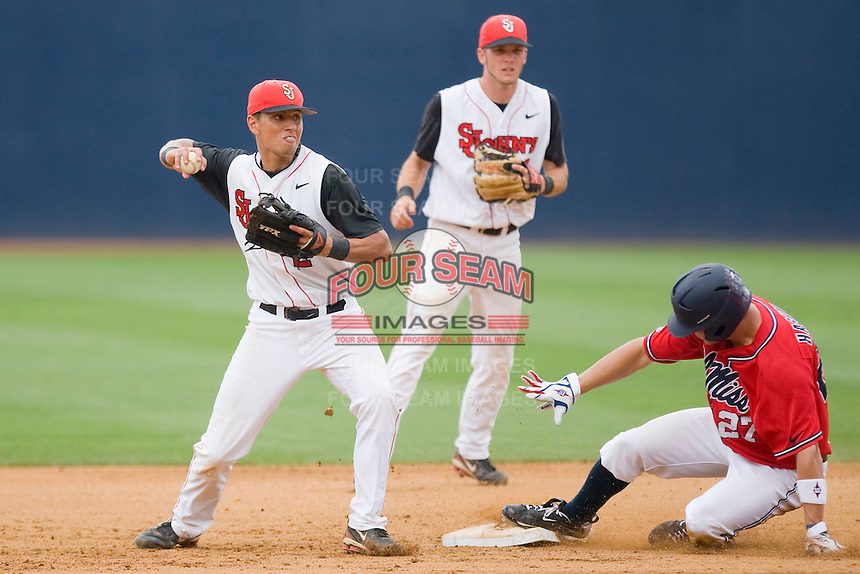 Shortstop Joe Panik #2 of the St. John's Red Storm turns a double play against the Ole Miss Rebels at the Charlottesville Regional of the 2010 College World Series at Davenport Field on June 6, 2010, in Charlottesville, Virginia.  The Red Storm defeated the Rebels 20-16.  Photo by Brian Westerholt / Four Seam Images