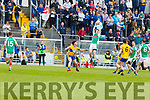 Clean catch by Ian McCarthy of Na Gaeil  as Darragh Behan of St Senans looks on, in the Junior Premier football championship final on Sunday.