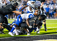 CONWAY VS BENTONVILLE  - Preston Crawford of Bentonville scores a touch down against Conway in the 2nd quarter.  Jayleen Vance (16) attempts to make the stop, at Tiger Stadium, Bentonville, AR, on Friday September 6. 2019,   Special to NWA Democrat-Gazette/ David Beach