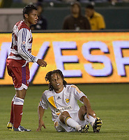 LA Galaxy MID Cobi Jones and FC Dallas FWD Carlos Ruiz during a MLS match. FC Dallas beat LA Galaxy 2-1 at the Home Depot Center in Carson, California, Thursday April 12, 2007.