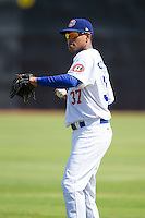Angel Sanchez (37) of the Chattanooga Lookouts warms up in the outfield prior to the game against the Montgomery Biscuits at AT&T Field on July 23, 2014 in Chattanooga, Tennessee.  The Lookouts defeated the Biscuits 6-5. (Brian Westerholt/Four Seam Images)