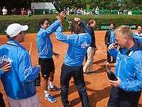 09-06-13, Tennis, Netherlands,The Hague, Playoffs Competition, The winners team the Lobbelaermaking a party