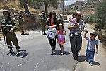 IDF Soldiers allow a Palestinain Family to pass a road block following a non violent demonstration in Beit Jala, near Bethlehem, on Sunday May 23th 2010.