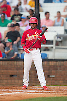 Eliezer Alvarez (11) of the Johnson City Cardinals checks with his third base coach for the sign before stepping up to the plate against the Bristol Pirates at Howard Johnson Field at Cardinal Park on July 6, 2015 in Johnson City, Tennessee.  The Cardinals defeated the Pirates 8-2 in game two of a double-header. (Brian Westerholt/Four Seam Images)