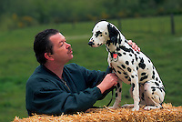Man talking to his dalmatian.