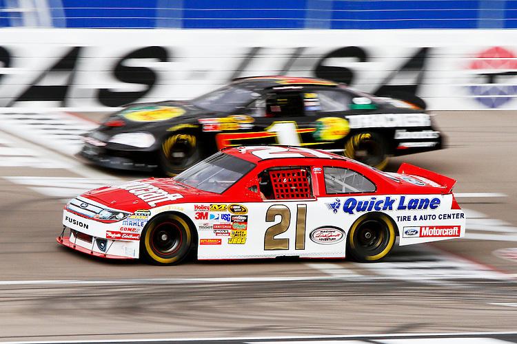 NASCAR stock cars race around Las Vegas Motor Speedway as part of the Dale Jarrett Racing Adventure.