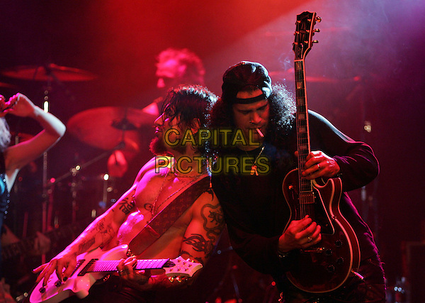 DAVE NAVARRO & SLASH .The Camp Freddy South East Asia Tsunami Relief Fund Benefit held at The Key Club in West Hollywood, California .January 27th, 2005.half length, stage, concert, live gig, music, guitar, tattoos, smoking, backwards, baseball cap, hat.www.capitalpictures.com.sales@capitalpictures.com.Supplied By Capital PIctures