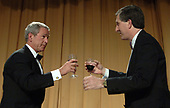 Washington, D.C. - April 29, 2006 -- United States President  George W. Bush is toasted by Mark Smith of the White House Correspondents' Association  during the associations annual dinner in Washington on April 29, 2006.    <br /> Credit: Roger L. Wollenberg - Pool via CNP