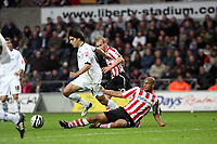 Pictured: Jordi Gomez of Swansea (L) tackled by David McGoldrick of Southampton (R). <br />