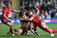 Rory Hutchinson of Northampton Saints is tackled by Nick Isiekwe of Saracens. Premiership Rugby Cup Final, between Northampton Saints and Saracens on March 17, 2019 at Franklin's Gardens in Northampton, England. Photo by: Patrick Khachfe / JMP