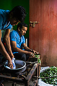 Workers cook and prepare the Patra Pinda Sueda (leaf treatment) for Ayurvedic treatments at the Nagarjuna Ayurvedic Centre in Kochi, Kerala, India.