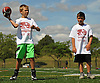 Michael Dietrich, 9, of Massapequa, left, throws the pigskin during the Long Island Youth Football Player Academy at Cedar Creek Park in Seaford on Monday, July 11, 2016.