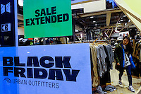 A woman searches by promotions inside of a store during Black friday promotions in New York.  10.28.2014. Eduardo Munoz Alvarez/VIEWpress