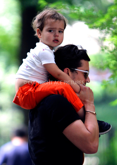 WWW.ACEPIXS.COM<br /> <br /> July 7 2013, New York City<br /> <br /> Actor Orlando Bloom takes his son Flynn for a walk around the Upper East Side on July 7 2013 in New York City<br /> <br /> By Line: Nancy Rivera/ACE Pictures<br /> <br /> <br /> ACE Pictures, Inc.<br /> tel: 646 769 0430<br /> Email: info@acepixs.com<br /> www.acepixs.com