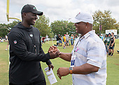 New York Jets head coach Todd Bowles, lewfdt, shakes hands with former teammate Brian Mitchell after his team participated in a joint training camp practice with the Washington Redskins at the Washington Redskins Bon Secours Training Facility in Richmond, Virginia on Monday, August 13, 2018.  They played together on the Redskins in 1990, 1992 and 1993, where they won Super Bowl XXVI.<br /> Credit: Ron Sachs / CNP<br /> (RESTRICTION: NO New York or New Jersey Newspapers or newspapers within a 75 mile radius of New York City)