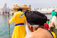 Asia,India,Punjab, Amristar, Golden temple,Palki Sahib where is the Sikh holy book,. The Sikh people never lave their turban ans Kirpan ( knife)