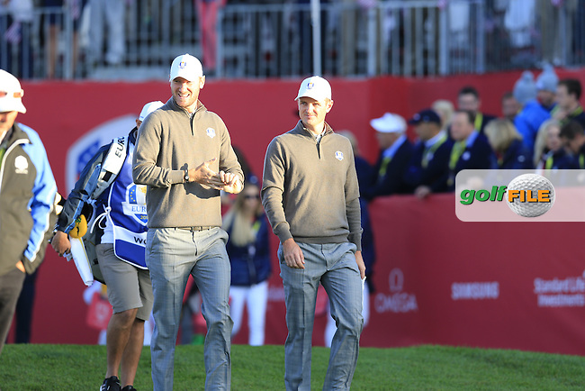 Chris Wood and Justin Rose (ENG) Team Europe walk off the 1st tee to start Saturday Morning Foursomes Matches of the 41st Ryder Cup, held at Hazeltine National Golf Club, Chaska, Minnesota, USA. 1st October 2016.<br /> Picture: Eoin Clarke | Golffile<br /> <br /> <br /> All photos usage must carry mandatory copyright credit (&copy; Golffile | Eoin Clarke)