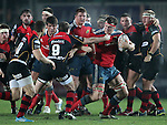 Robin Copeland of Munster Rugby is challenged by Scrum half Richie Rees of Newport Gwent Dragons.<br /> <br /> Guiness Pro 12<br /> Newport Gwent Dragons v Munster Rugby<br /> Rodney Parade<br /> 21.11.14<br /> ©Steve Pope-SPORTINGWALES