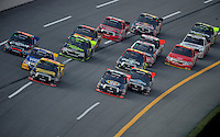 Oct 4, 2008; Talladega, AL, USA; NASCAR Craftsman Truck Series driver Todd Bodine (30) leads the field on the last lap during the Mountain Dew 250 at the Talladega Superspeedway. Mandatory Credit: Mark J. Rebilas-