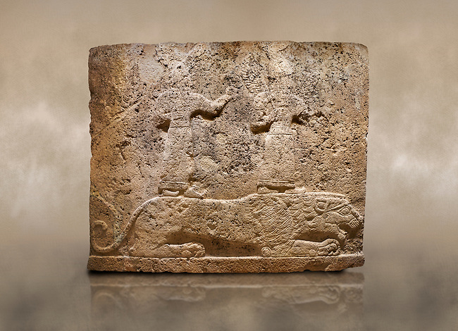 Photo of Hittite relief sculpted orthostat stone panel of Long Wall Limestone, Karkamıs, (Kargamıs), Carchemish (Karkemish), 900-700 B.C. Anatolian Civilisations Museum, Ankara, Turkey<br /> <br /> Two figures lying over the lion. There is a crescent at the head of the winged god at the front. It is thought that the figure at the front is moon god and the one at the rear is sun god. <br /> <br /> On a brown art background.