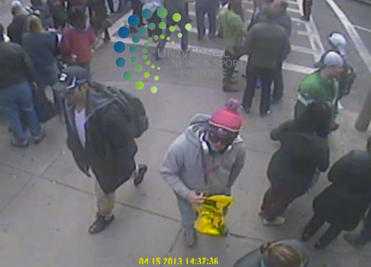The FBI has released photos of two suspects it wants to identify as part of the investigation into Monday's Boston marathon bombings..CCTV captured the two men, one wearing a dark-coloured baseball cap and the other a white cap, near the scene..FBI Agent Richard DesLauriers warned members of the public not to approach the two men..Picture: FBI/Universal News And Sport (Europe) 18 April 2015.