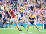 David Reidy of Clare celebrates his goal watched by Shane O Donnell of Clare and Eoin Cadogan of Cork during their Munster senior hurling final at Thurles. Photograph by John Kelly.