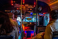 Travel Print Photograph of a night scene on a Mexican bus in Puerto Vallarta, Mexico.