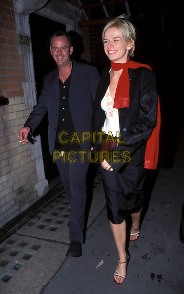 NORMAN COOK & ZOE BALL.fatboy slim red scarf full length couple married black skirt jacket blue suit.Ref: 9337.February 9th, 2000.www.capitalpictures.com.sales@capitalpictures.com.©Adam Houghton/Capital Pictures.