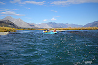 Eric Downey and Cathy Hart float their raft down the Sheenjek River, with Alaska's Brooks Range in the background, in the Arctic National Wildlife Refuge, through fall colors in late August. MR Sheenjek.pdf