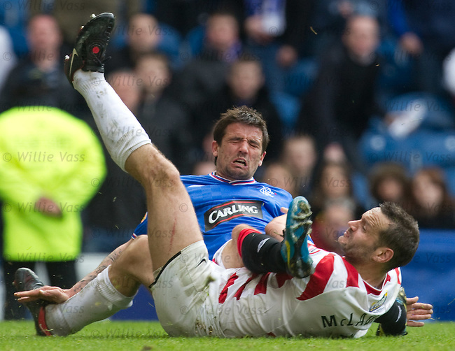 Mark McLaughlin tackles Rangers striker Nacho Novo as he is about to shoot and takes the little striker out