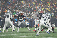 FOXBOROUGH, MA - NOVEMBER 24: New England Patriots Quarterback Tom Brady #12 looks down the field to pass while New England Patriots Offensive lineman Joe Thuney #62 holds off Dallas Cowboys Defensive tackle Antwaun Woods #99 during a game between Dallas Cowboys and New England Patriots at Gillettes on November 24, 2019 in Foxborough, Massachusetts.