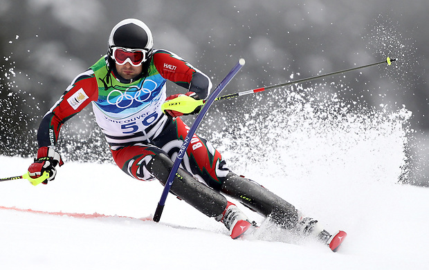 Bulgaria's Stefan Georgiev cuts around a gate in the men's slalom at the XXI Olympic Winter Games Saturday, February 27, 2010 in Whistler, British Columbia.