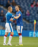 Kenny Miller passes the captain's armband to Danny Wilson