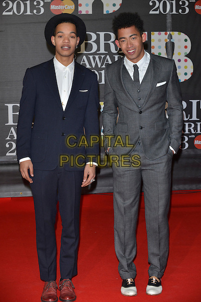 Harley Alexander-Sule, Jordan Stephens of Rizzle Kicks .The Brit Awards 2013 arrivals at the O2, Greenwich, London, England 20th February 2013.The Brits full length band group navy blue grey gray suit tie white shirt  hat .CAP/PL.©Phil Loftus/Capital Pictures.