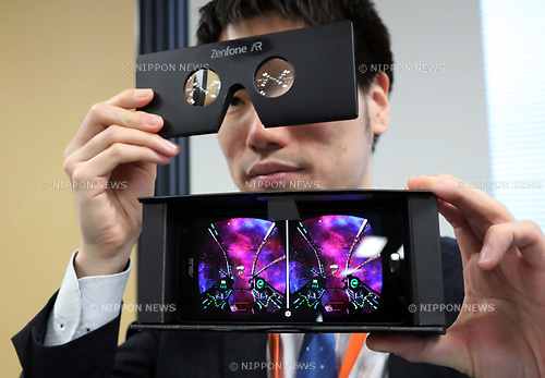 """April 13, 2017, Tokyo, Japan - Taiwan's electronic maker ASUS introduces its latest smart phone """"ZenFone AR"""" at a press preview in Tokyo on Thursday, April 13, 2017.  The world's first Tango and Daydream AR and VR ready smart phone displays virtual image against a photo on a 5.7-inch OLED screen using augmented reality (AR) technology. It will go on sale this summer with a price of 99,800yen.   (Photo by Yoshio Tsunoda/AFLO) LwX -ytd-"""