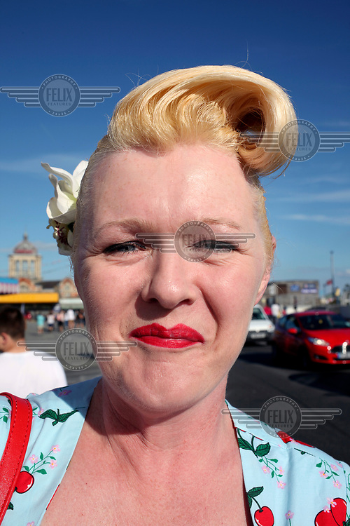 A woman with a blonde quiff on the seafront at Southend-On-Sea.