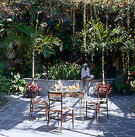 Breakfast served on an iron table in the lush garden of villa Beracasa designed by architect Gio Ponti in the late 50s
