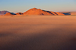 Namibia, Namib Desert, Namibrand Nature Reserve, aerial view of fairy circle plain with Inselberg: fairy circles are believed to be caused by termites