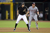 Arizona Diamondbacks pinch runner Tony Campana (19) leads off first in front of Chad Tracy (18) during a game against the Washington Nationals at Chase Field on September 28, 2013 in Phoenix, Arizona.  Washington defeated Arizona 2-0.  (Mike Janes/Four Seam Images)