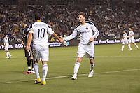 LA Galaxy midfielders Landon Donovan (10) and David Beckham (23) exchange low fives. The LA Galaxy defeated the Philadelphia Union 1-0 at Home Depot Center stadium in Carson, California on  April  2, 2011....
