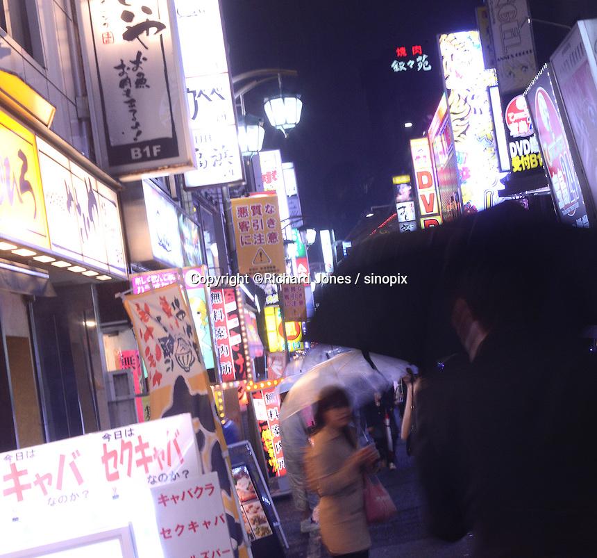 Kabukicho, Tokyo's notorious night town at night, There are various bars, restaurants, host club, hostess bar, peep show, sex shops and cabarret managed by Yakuza, gangstars in Kabukicho, Shinjuku, Tokyo